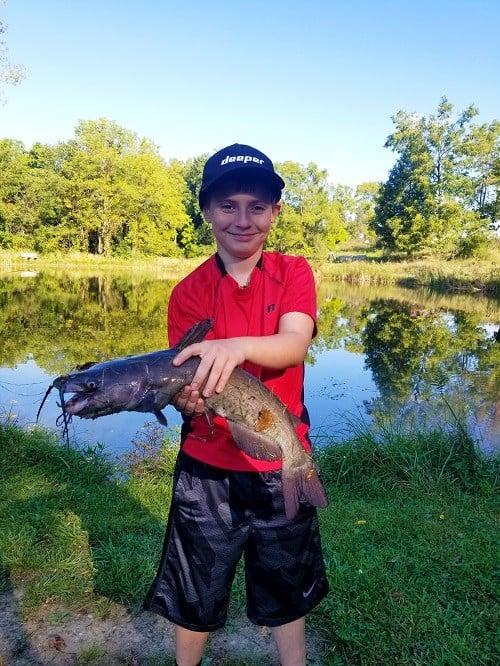 Kid holding fish